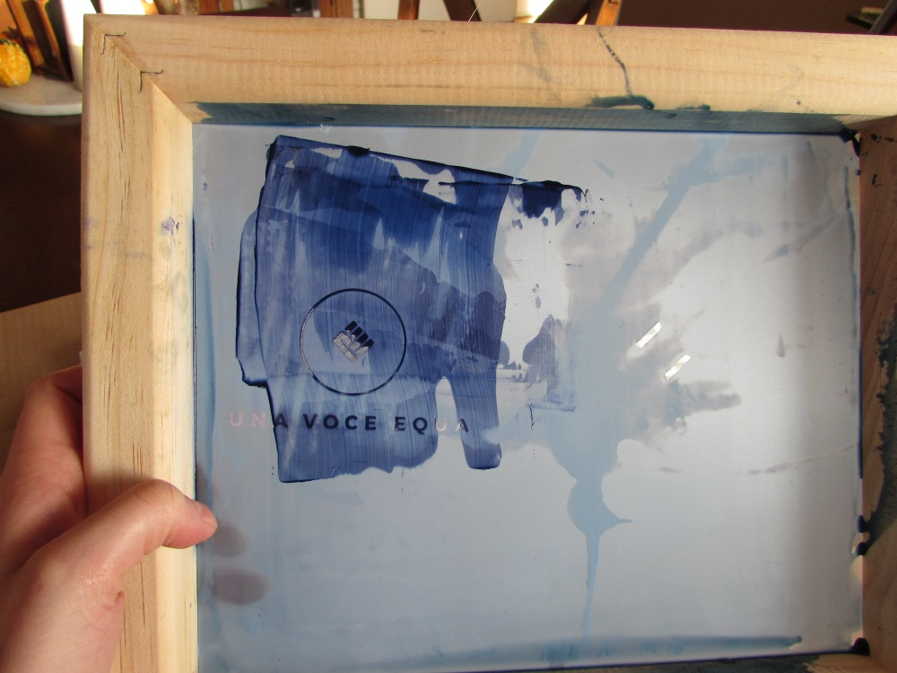 """9babced80 Only ink applied to the """"negative"""" spaces of the screen will transfer to  the shirt. This is what a screen looks like after the screen printing  process."""